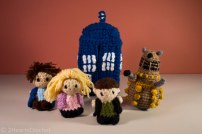 From left to right: Captain Jack Harkness, Rose Tyler, Nine, and a dalek